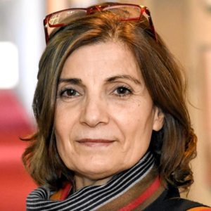 Shahla Talebi is a social cultural anthropologist who lived in Iran through the 1979 Revolution and the Iran-Iraq War (1980-1988). She came to the United States in 1994 where she received her B.A. from University of California, Berkeley, and her MA and PhD from Columbia University, all in sociocultural anthropology. Talebi is currently an associate professor of religious studies and anthropology of religion in the school of historical, philosophical and religious studies at Arizona State University. Talebi's scholarship is deeply impacted by her lived experiences of these profound historical events and her activism. Her work revolves around questions of revolution, state, violence, mass incarceration, imprisonment, memory, mourning and memorialization, with a significant focus on women and gender. Her work also deals with language, metaphor, embodied performances, and commemorative rituals. Talebi is the author of awards winning book, Ghosts of Revolution: Rekindled Memories of imprisonment in Iran. Her work has also appeared in academic journals and in edited books. In addition to other topics of her research, she has been invited to speak in various academic and non-academic venues on women's day. Presently, Talebi is completing her second book manuscript on the contested martyrdoms in post-revolutionary Iran.